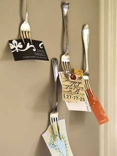 Forks on the kitchen wall for notes or children's artwork?