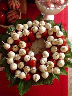 twenty something bows: Parties - Basil, Cherry Tomato, Marinated Mozzarella Ball Skewer/Toothpick Bites, arranged on platter in a wreath shape