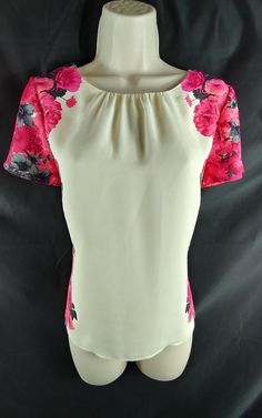 "~Ladies Size Petite 10P – 39"" around the bust. From the top of the shoulder, to the very bottom of the hem, the length is 23.5"" long. ~Multi-color floral short sleeve, keyhole back blouse. 100% Polyester. 