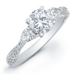 I dont normally like pear shape diamonds, and Im also not a huge fan of tri-stone settings...and yet I think this ring is unbelievably stunning!    Three- Stone Engagement Ring-Pear Shape Side Stones alright-i-give-i-ll-start-planning-my-future-weddi