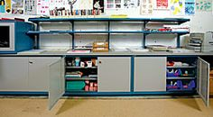 Counter height shelf cabinets. Ample storage for a variety of bulky supplies topped with counter top work area.