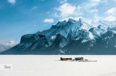 Frozen Boathouse in Lake Minnewanka Banff Nationa by GaryArndt  alberta banff canada ice lake mountains outdoors snow travel GaryArndt