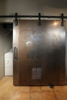 Industrial metal barn door - hidden laundry