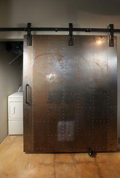 Industrial metal barn door - hidden laundry