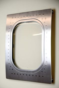 This airplane window was cut from a 767 and turned into a custom aviation decoration wall hanging. It has been sanded and polished to abrushed f...