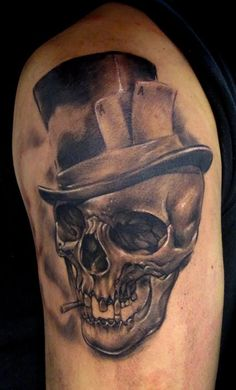 Smoking skull with hat tattoo