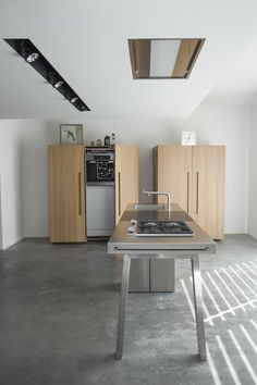 German kitchen line Bulthaup offers kitchens in cabinets: one conceals pantry goods; the other, appliances. See Good Küchen: 9 German Kitchen Systems. Kitchen Vent, Hidden Kitchen, Kitchen Hoods, Kitchen Island, Kitchen Cabinets, Bulthaup Kitchen, Cocinas Kitchen, Kitchen Furniture, Kitchen Interior