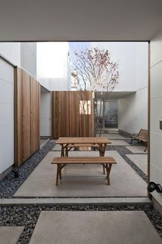 Concrete slabs & pea gravel. Love the 2 together but not necessarily this contrived