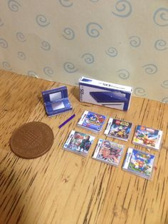 Dolls house handmade miniature nintendo ds bundle (boys) - blue ds console, console box and 6 tiny ds games scale Ava Doll, Miniature Crafts, Miniature Food, Ds Games, Mini Craft, Mini Things, Small Things, Nintendo Ds, Nintendo Switch