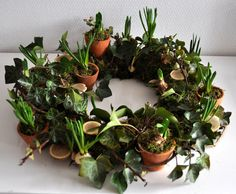 Use wreathes for various centerpieces. Could use candles in the middle with glass or not.