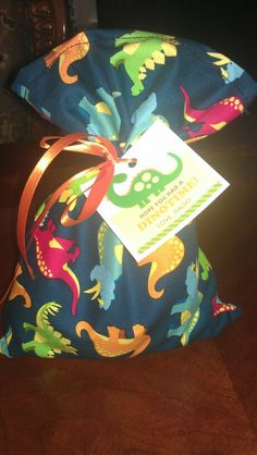 Made these candy bags for my son's 2nd bday party dinosaur theme.. The material I bought it from Hobby lobby...