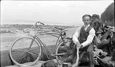 Philip Timms, early Vancouver photographer, and bicycle at Spanish Banks