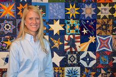 Astronaut Karen Nyberg poses wifth her and others' star-themed blocks at the International Quilt Festival in Houston, Oct. 30, 2014.