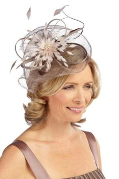 Mother of the bride hairstyle and fascinator.