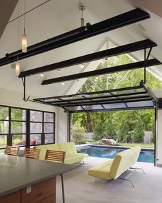 Garage patio designs living room contemporary with glass garage door steel beams pool house