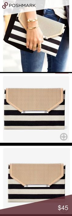 City Slim Clutch Black/Cream Clean Stripe City Slim Clutch Black/Cream Clean Stripe • gently used like new condition •used as a sample •7 1/2 inches x 10 inches Stella & Dot Bags Clutches & Wristlets
