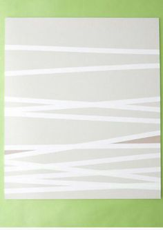 CHEAP wall art..... tape off any pattern on the canvas, and paint with any color!