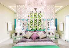 Light, feminine bedroom with an interesting geometric divider