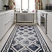 Carreaux ciment blanc et noir pour une cuisine à la déco vintage et moderne à la fois
