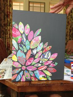 Fun wall accessory using old Lilly agenda pages on a painted canvas!