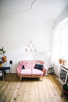 Battered pink sofa