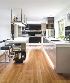 Contemporary Australian kitchen designBrisbane-based interior design studio, Interiors by Darren James, has completed a contemporary kitchen design for a German family living in Australia.