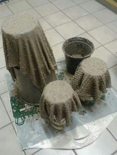 Old cloth soak it in cement water.. Drape it to dry... Paint... Flower pots!