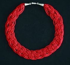 Tutorial: Woven Seed Bead Necklace - This is one of the most stunning seed bead patterns ever! Weave together strands of seed beads to create a an intricate and elegant collar necklace with this tutorial.