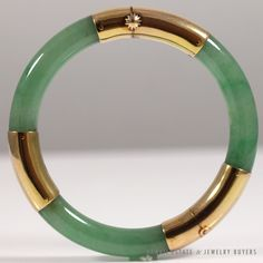 34b7c999050 VINTAGE JADE GREEN 14K YELLOW GOLD HINGED BANGLE BRACELETMore  #vintagejewelry #jewelryauctions on our website