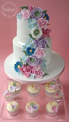 Floral Cascade Wedding Cake by The Clever Little Cupcake Company  - http://cakesdecor.com/cakes/243540-floral-cascade-wedding-cake