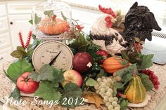 Fall vignette on a tray includes a tiny cloche with a tiny pumpkin.