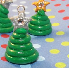 Hey, I found this really awesome Etsy listing at http://www.etsy.com/listing/85683330/christmas-tree-polymer-clay-charm-with