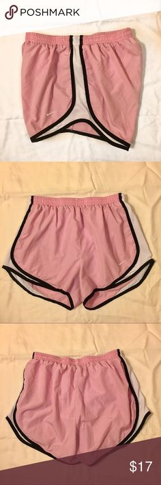 Pink Nike shorts Pink, black, and white Nike shorts. In the shorts are in great condition except for the small pocket. The inside of the pocket has a pretty big stain (pictured) I'm not sure what it is.. Nike Shorts