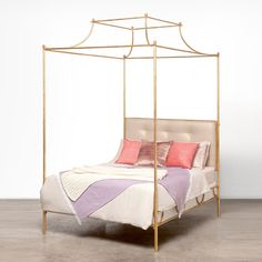 A grand canopy top is the striking detail of this bed's silhouette, giving it an air of understated elegance. The Janelle offers subtle luxury with scallop details, a smooth finish, and a full range of customization, including four different frame colors and interchangeable headboards available in six unique materials or upholstery.    Finish: Gold Smooth Iron (Shown), Bronze Smooth Iron, White Smooth Iron, Silver Smooth Iron
