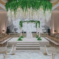 The greenery coated ceiling created by The Empty Vase for this #BeverlyHills, #California #wedding held at the Beverly Wilshire is a fresh, vibrant take on a traditional #chuppah design. #SpringWedding perfection. Instagram repost: @theemptyvase  | WedLuxe Magazine | #luxury #wedding #weddinginspiration #decorinspiration