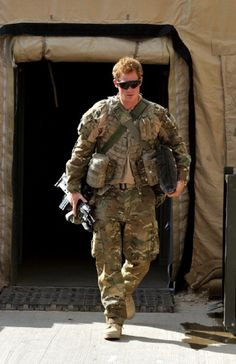Prince Harry walks through the British controlled flight-line in Camp Bastion on 31 Oct 2012 in Afghanistan.