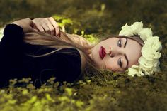 Girl flowers in hair laying down