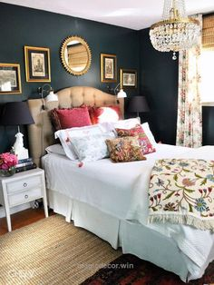Nice i'm usually a light paint color type of gal but i am loving this navy accent wall behind the bed. The white duvet really pops. and of course, hello chandelier!  The  ..
