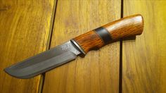 Hunting knife. Suminagashi laminated PM steel with SG-2 core. Wooden handle - sheoak and ebony wood.