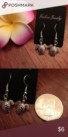 Sea turtle earrings NWT. Silver tone earrings with sea turtle charms. Great accessory for your next tropical vacation. Be sure to check out my other earrings! 5% discount on bundles. Jewelry Earrings