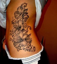 Thinking about adding on to my rose rib piece Realistic black ink flower tattoo on side body
