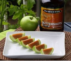 CARAMEL APPLE JELLO SHOTS 6 green Apples 3 lemons 1 packet gelatin 1/2 cup water 1 packet hot chocolate 1/2 cup coconut milk 1/4 cup sugar 2 drop yellow food coloring 1/2 oz. (15ml) vodka 1/2 oz. (15ml) butterscotch schnapps
