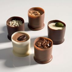 Belgian pralines in chocolate cups.:)) I'm sure they're overly expensive. it might be worth it. Praline Chocolate, Artisan Chocolate, Chocolate Sweets, Chocolate Shop, Chocolate Cups, Chocolate Recipes, Fancy Desserts, Delicious Desserts, Candy Recipes