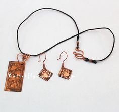 """#OOAK Etched #Copper #Pawprint #Necklace and #Earrings by ButterflySundries, $65.00    Does your pet walk all over you? Do you feel like you have paw prints claiming you as your pet's very own? If so, you might appreciate this one-of-a-kind etched paw prints necklace and earring set!    This is one of the original """"Fur Babies"""" designs I've created for my March-May 2013 Featured #Charity: Spokane Humane Society!  #FurBabies #FurBaby #paw #cat #dog #pet #handmade #choker #metal #metalwork"""