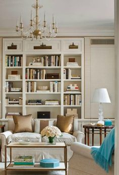 Design Chic: In Good Taste: Cullman and Kravis Design. Neutral Living room with turquoise pops. Lovely bookcase styling
