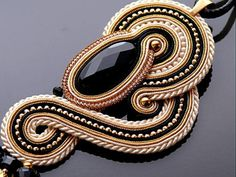 Gold ecru Soutache necklace with Onyx and Hematite .