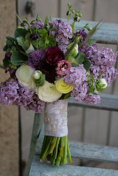 April:  Lilac, ranunculus, tulips, hellebore, wheat, allium, ornamental cabbage, cerinthe, and aquilegia.