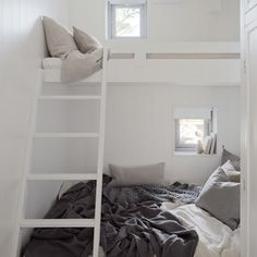 interesting idea to save space in kiddo suite.  Small rooms with built in beds and closet spaces, connect to a shared bath in between but open up to a community room for play (homework) etc.