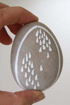 A hand-painted stone depicting water droplets.  Use it for meditation, as paper weight, or for home decor.  The Chinese character for water is written on the back.  By www.EchidnaArtandCards.etsy.com.