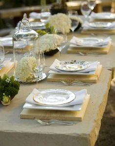 Things We Love...A Uniquely Set Dinner Table — Providence Design. Crude wooden board used as base for plates....charmingly rustic